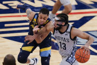 Georgetown's Donald Carey, right, drives past Marquette's Greg Elliott during the second half of an NCAA college basketball game in the Big East conference tournament Wednesday, March 10, 2021, in New York. (AP Photo/Frank Franklin II)