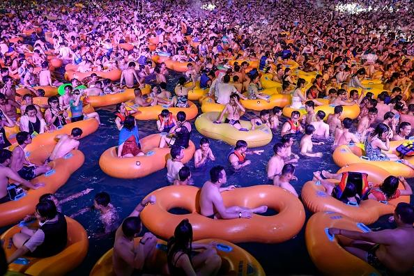 This photo shows people watching a performance as they cool off in a swimming pool in Wuhan in China's central Hubei province.
