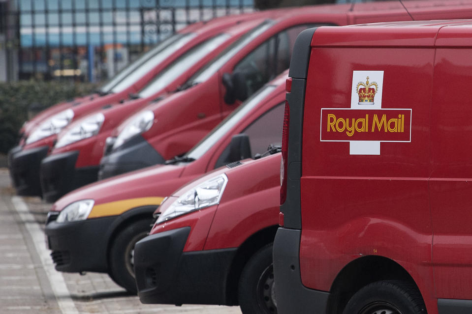 Royal Mail delivery vans are parked at the Mount Pleasant sorting office in London on December 19, 2016. (Photo by Justin TALLIS / AFP) (Photo by JUSTIN TALLIS/AFP via Getty Images)