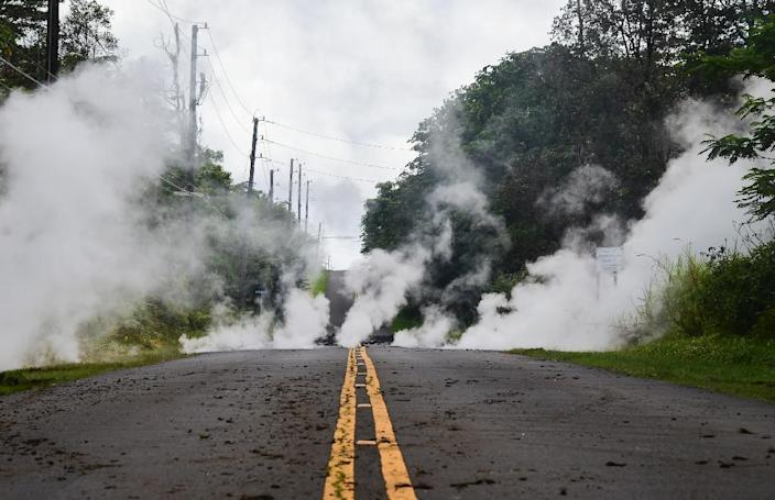 Steam rises from a fissure on a road in on Hawaii's Big Island (AFP Photo/FREDERIC J. BROWN)