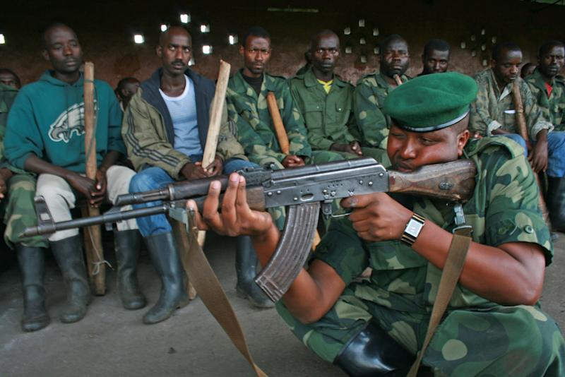 FILE - In this file photo taken on Tuesday, Oct. 23, 2012, M23 rebels conduct training exercises in Rumangabo, eastern Congo. The Rwandan-backed rebel group advanced to within 4 kilometers (2.4 miles) of Goma, a crucial provincial capital in eastern Congo, marking the first time that rebels have come this close since 2008. Congolese army spokesman Col. Olivier Hamuli said the fighting has been going on since 6 a.m. Sunday, Nov. 18, 2012, and the frontline has moved to just a few kilometers (miles) outside the city. (AP Photo/Stephen Wandera,File Photo)