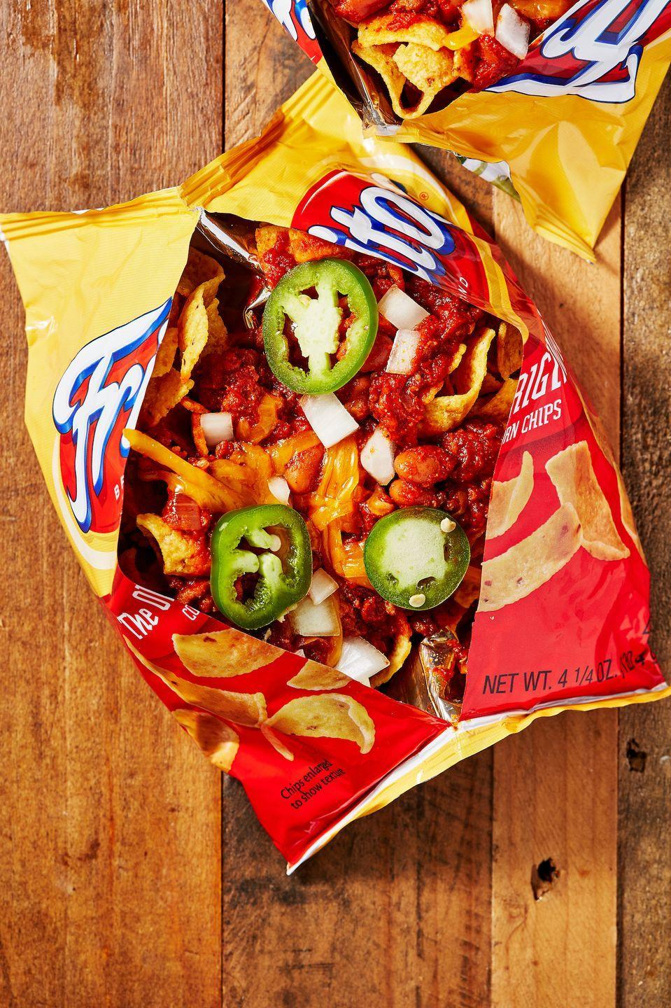 """<p>Did ya know? These were originally created in Mexico but popularized in the American Southwest.</p><p>Get the recipe from <a href=""""https://www.delish.com/cooking/recipe-ideas/a28914527/frito-pie-recipe/"""" rel=""""nofollow noopener"""" target=""""_blank"""" data-ylk=""""slk:Delish"""" class=""""link rapid-noclick-resp"""">Delish</a>.</p>"""