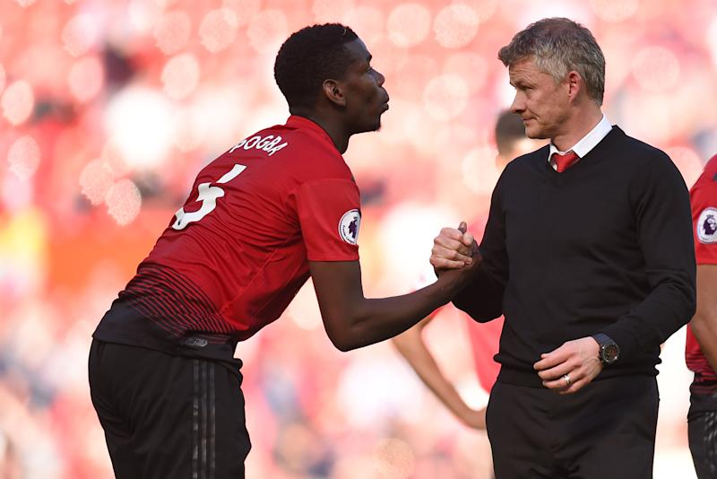 Manchester United's French midfielder Paul Pogba (L) shakes hands with Manchester United's Norwegian manager Ole Gunnar Solskjaer (R) on the pitch after the English Premier League football match between Manchester United and Cardiff City at Old Trafford in Manchester, north west England, on May 12, 2019. - Cardiff won the game 2-0. (Photo by Oli SCARFF / AFP) / RESTRICTED TO EDITORIAL USE. No use with unauthorized audio, video, data, fixture lists, club/league logos or 'live' services. Online in-match use limited to 120 images. An additional 40 images may be used in extra time. No video emulation. Social media in-match use limited to 120 images. An additional 40 images may be used in extra time. No use in betting publications, games or single club/league/player publications. / (Photo credit should read OLI SCARFF/AFP/Getty Images)
