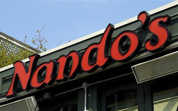 The nando's sign above a restaurant