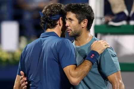 Tennis - ATP 500 - Dubai Tennis Championships - Dubai Duty Free Tennis Stadium, Dubai, United Arab Emirates - February 27, 2019 Switzerland's Roger Federer embraces Spain's Fernando Verdasco after their Quarter Final match. REUTERS/Ahmed Jadallah