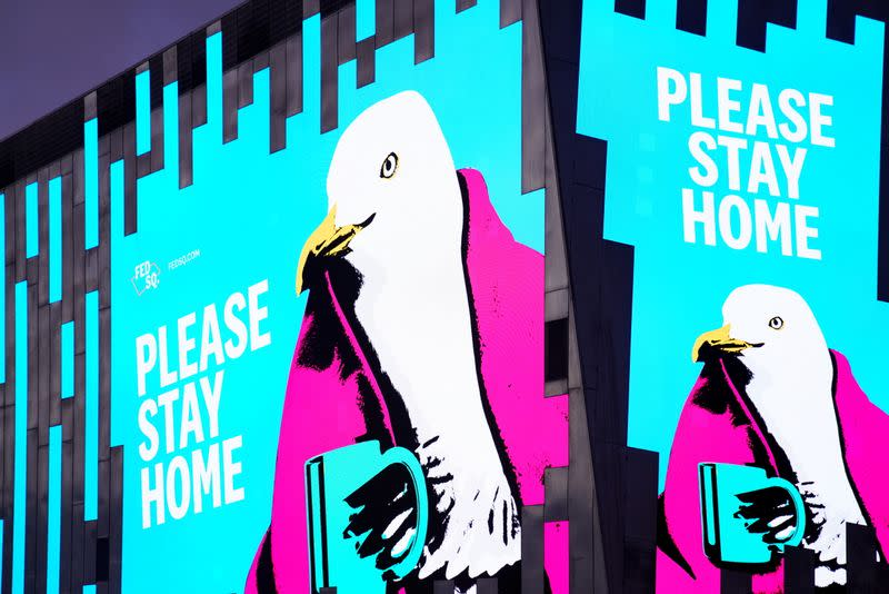'Please Stay Home' signs are seen on the first day of a seven-day COVID-19 lockdown in Melbourne