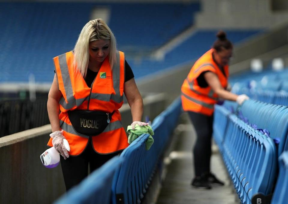 Ground staff disinfect seats ahead of a Premier League match at the Amex Stadium in Brighton (Kieran Cleeves/PA) (PA Wire)
