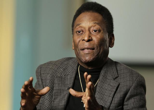 """FILE - In this April 2, 2014 file photo, Pele gestures during an interview at The Associated Press in New York. Brazil's World Cup ambassador says he's concerned about the country's outdated airports less than 10 weeks before the tournament begins. """"It's a concern. I arrived from a trip a few days ago and there was chaos at the airport,"""" Pele said Monday, April 7, 2014, at an event to launch a diamond collection honoring his career. (AP Photo/Mark Lennihan, File)"""