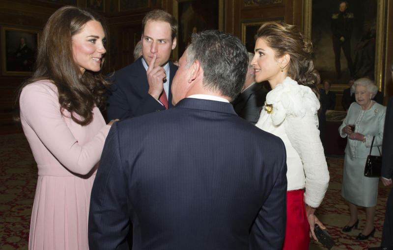 Queen Elizabeth II, right, looks on as the Duke and Duchess of Cambridge chat with King Hussein and Queen Rania of Jordan as guests arrive at a lunch for sovereign monarchs of the world, held in honour of the queen's Diamond Jubilee, at Windsor Castle, in Windsor,  Friday May 18, 2012.  Critics are aghast at the choice of some guests for the  lunch _ among them a king whose Gulf nation has been engaged in a brutal crackdown on political dissent. (AP Photo/ Arthur Edwards, Pool)