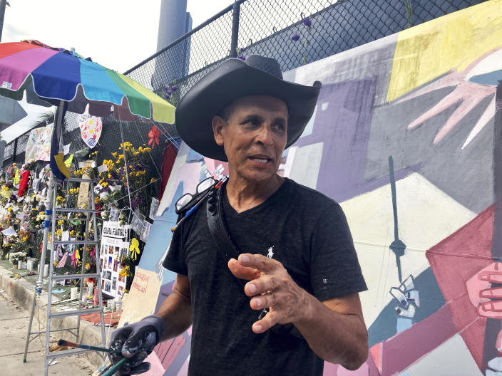 Roberto Marquez his mural, Friday, July 9, 2021 in Surfside, Fla. Roberto Marquez flew from Dallas to Miami nearly two weeks ago, hoping to add his hands to those digging through the rubble of a fallen South Florida condo building. But once there, the muralist was disappointed to hear that his help was appreciated but not needed. Still, the Dallas artist felt compelled to contribute to the cause, something that might uplift the Surfside community amid so much anguish. That's when he decided he would use his art to help translate pain into hope and resilience. (AP Photo/ Stacey Plaisance)