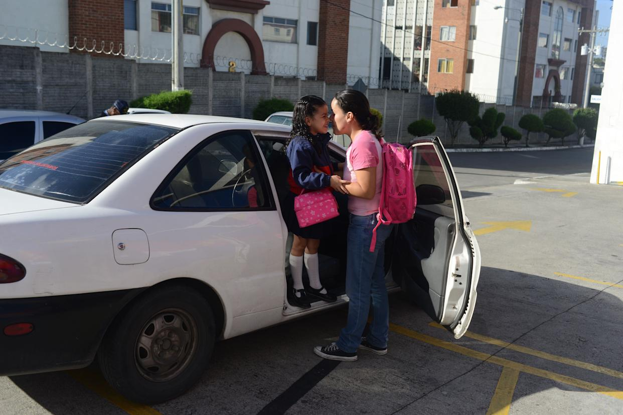 Margarita Samayoa kisses her 6-year-old daughter, Valentina Rodas, before she goes to school in Guatemala City on July 8, 2013.