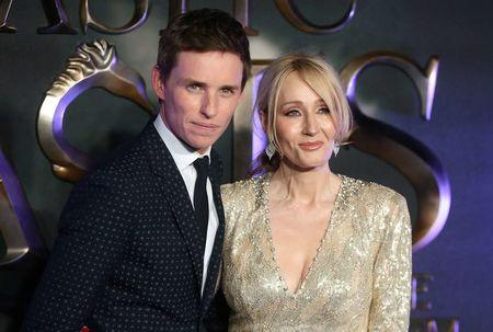 """Actor Eddie Redmayne poses with writer J.K. Rowling as they arrive for the European premiere of the film """"Fantastic Beasts and Where to Find Them"""" at Cineworld Imax, Leicester Square in London"""
