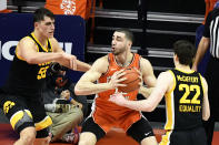 Illinois forward Giorgi Bezhanishvili is pressured by Iowa center Luka Garza (55) and forward Patrick McCaffery (22) in the first half of an NCAA college basketball game Friday, Jan. 29, 2021, in Champaign, Ill. (AP Photo/Holly Hart)
