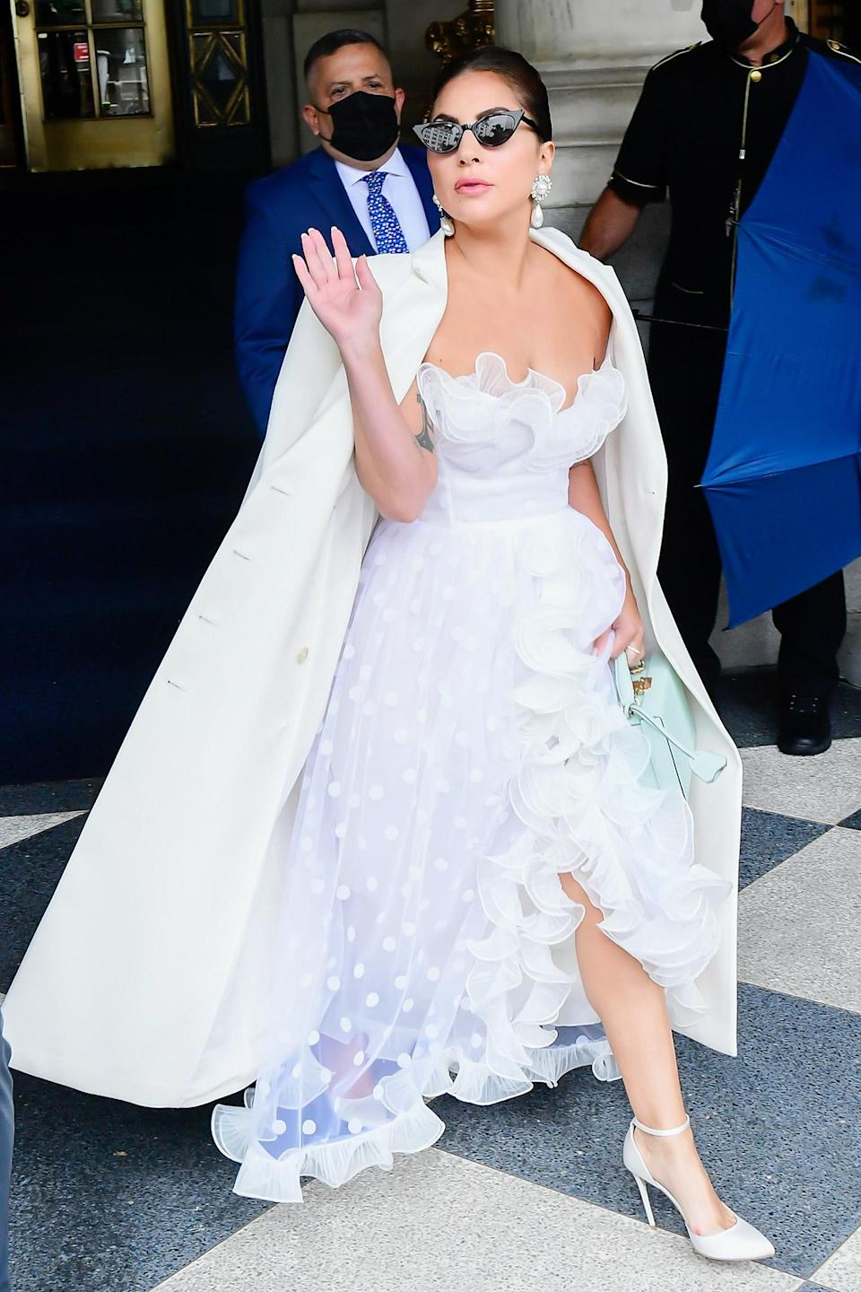 <p>Lady Gaga wears a gorgeous white gown and waves to fans while out in midtown N.Y.C. on July 1.</p>