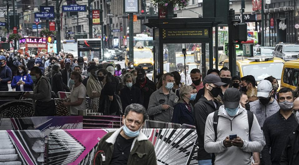 Voters in masks crowd a sidewalk outside Madison Square Garden.