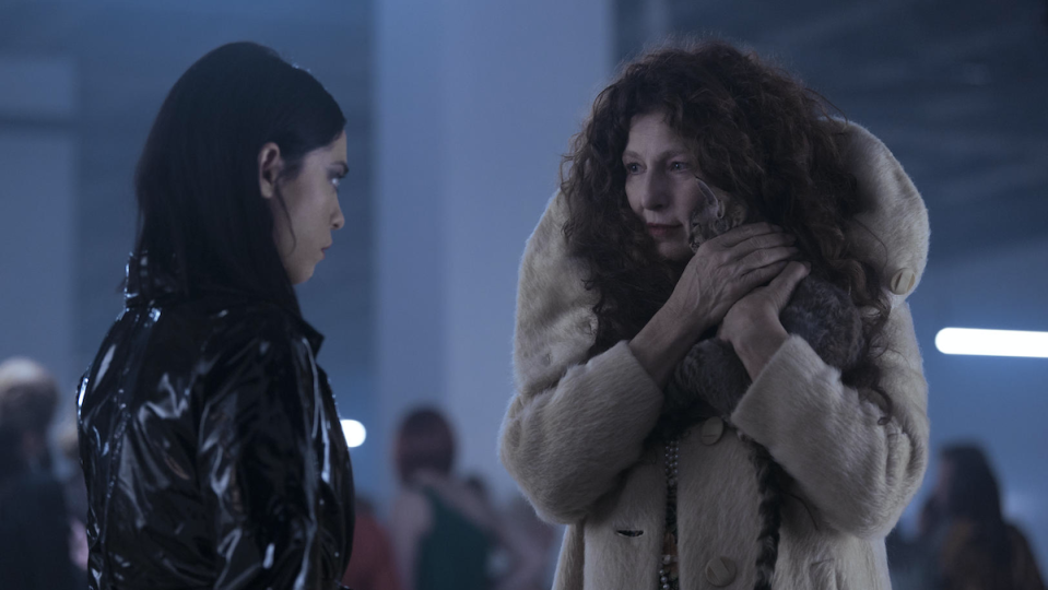 Rose Salazar looks at Catherine Keener, who cradles a cat.