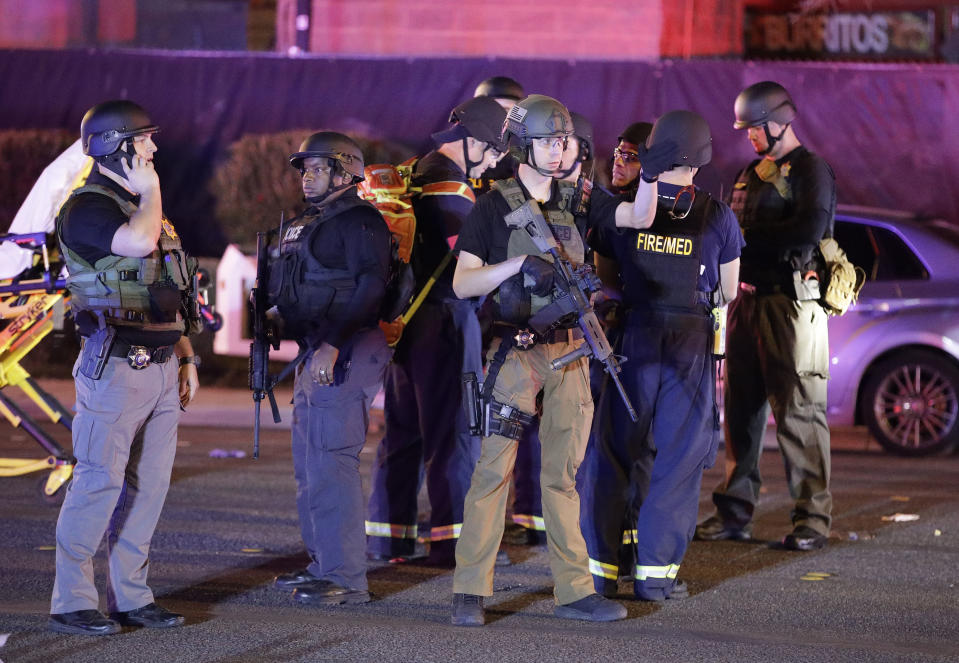 <p>Police officers stand at the scene of a shooting near the Mandalay Bay resort and casino on the Las Vegas Strip, Monday, Oct. 2, 2017, in Las Vegas. Multiple victims were being transported to hospitals after a shooting late Sunday at a music festival on the Las Vegas Strip. (AP Photo/John Locher) </p>