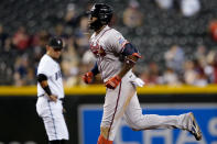 Atlanta Braves' Jorge Soler rounds the bases after hitting a solo home run as Arizona Diamondbacks' Ildemaro Vargas looks on during the fifth inning of a baseball game, Tuesday, Sept. 21, 2021, in Phoenix. (AP Photo/Matt York)