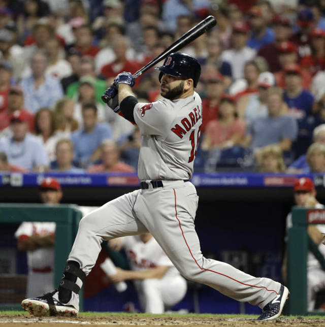 Boston Red Sox's Mitch Moreland follows through after hitting a three-run double off Philadelphia Phillies starting pitcher Vince Velasquez during the third inning of a baseball game Wednesday, Aug. 15, 2018, in Philadelphia. (AP Photo/Matt Slocum)
