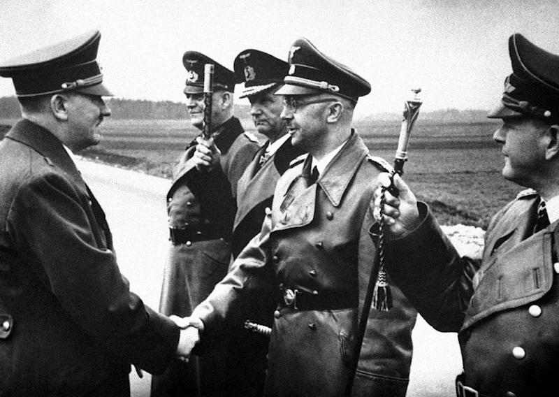 "FILE - The May 18, 1944 file photo shows then German Chancellor Adolf Hitler, left, shaking hands with German Interior Minister and head of the SS, Heinrich Himmler, somewhere in Germany. From left to right; Hitler, Minister Field Marshal Wilhelm Keitel, Admiral Karl Doenitz, Himmler and Field Marshal General Erhard Milch. German newspaper Welt am Sonntag has published a trove of letters believed to be written by Himmler. On seven full pages the paper on Sunday Jan. 26,2014 showed pictures of Himmler and his family smiling into the camera during a fishing trip, the top Nazi taking a bath in a lake or feeding a little fawn. The newspaper, which says the material is contained in an eight-part series it plans to publish, also quotes excerpts from Himmler's love letters addressing his wife as ""my sweet, beloved little woman."" Welt said it worked together with Israeli film director Vanessa Lapa, whose family had the documents in its possession. (AP Photo/str,File)"
