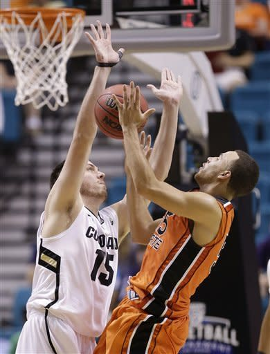 Oregon State's Roberto Nelson (55) is fouled by Colorado's Shane Harris-Tunks while shooting in the second half during a Pac-12 tournament NCAA college basketball game on Wednesday, March 13, 2013, in Las Vegas. Colorado won 74-68. (AP Photo/Julie Jacobson)