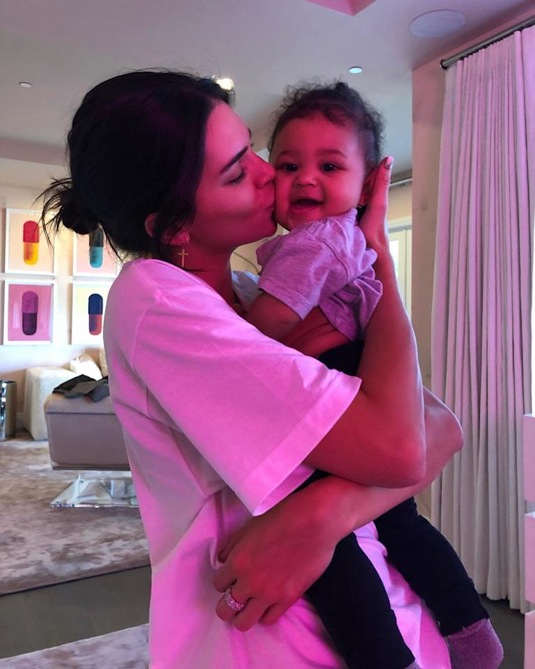 And snuggled up to sis Kylie Jenner's daughter Stormi.