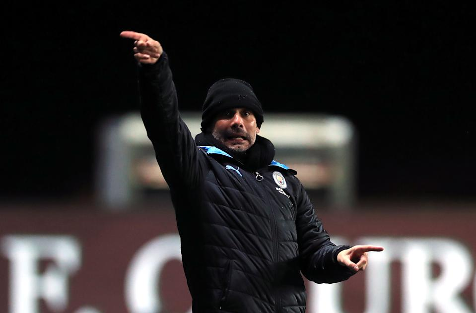Manchester City manager Pep Guardiola gestures on the touchline on the touchline during the Carabao Cup quarter final match at Kassam Stadium, Oxford. (Photo by Mike Egerton/PA Images via Getty Images)