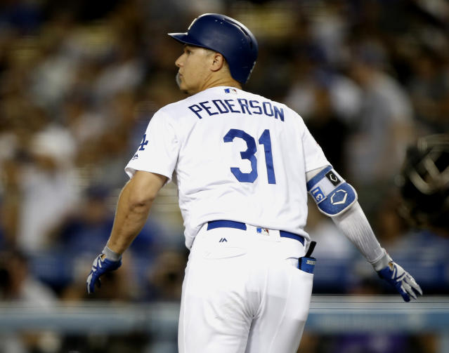 Los Angeles Dodgers' Joc Pederson watches his solo home run against the Colorado Rockies during the first inning of a baseball game in Los Angeles, Monday, Sept. 17, 2018. (AP Photo/Alex Gallardo)