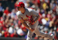 St. Louis Cardinals starting pitcher Miles Mikolas works against the Colorado Rockies in the first inning of a baseball game Thursday, Sept. 12, 2019, in Denver. (AP Photo/David Zalubowski)