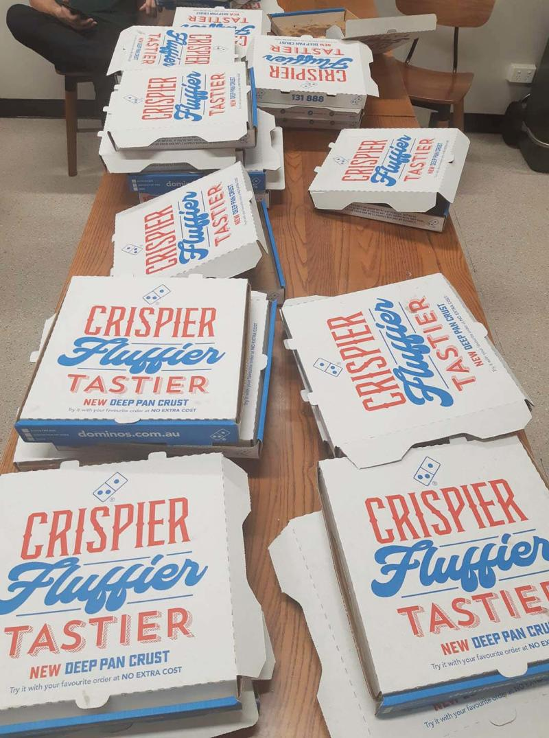 A table of Domino's pizza boxes