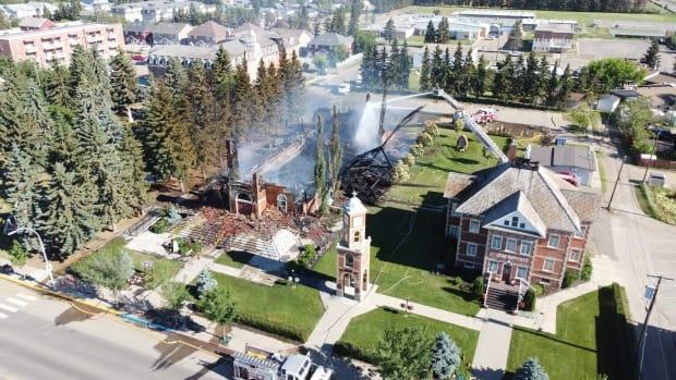 A fire destroyed the century-old Catholic church in Morinville, Alta., about 30 kilometres north of Edmonton, on June 30. (David Bajer/CBC - image credit)