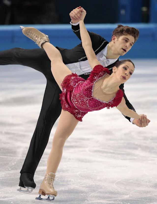Nicole Della Monica and Matteo Guarise of Italy compete in the pairs free skate figure skating competition at the Iceberg Skating Palace during the 2014 Winter Olympics, Wednesday, Feb. 12, 2014, in Sochi, Russia. (AP Photo/Ivan Sekretarev)