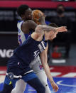 Detroit Pistons forward Sekou Doumbouya (45) is fouled by Minnesota Timberwolves forward Juancho Hernangomez (41) during the second half of an NBA basketball game, Tuesday, May 11, 2021, in Detroit. (AP Photo/Carlos Osorio)