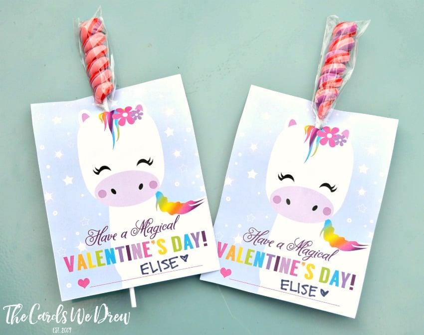 """<p>Free printables and <a href=""""https://www.popsugar.com/buy?url=https%3A%2F%2Fwww.amazon.com%2FFun-Express-Rainbow-Twisty-Edibles%2Fdp%2FB07N7S2QZQ%2Fref%3Dsr_1_10&p_name=unicorn%20horn%20suckers&retailer=amazon.com&evar1=moms%3Aus&evar9=47156082&evar98=https%3A%2F%2Fwww.popsugar.com%2Fphoto-gallery%2F47156082%2Fimage%2F47156087%2FMagical-Unicorn-Valentine&list1=valentines%20day%2Cfood%20and%20activities%2Ckid%20crafts&prop13=api&pdata=1"""" rel=""""nofollow"""" data-shoppable-link=""""1"""" target=""""_blank"""" class=""""ga-track"""" data-ga-category=""""Related"""" data-ga-label=""""https://www.amazon.com/Fun-Express-Rainbow-Twisty-Edibles/dp/B07N7S2QZQ/ref=sr_1_10"""" data-ga-action=""""In-Line Links"""">unicorn horn suckers</a> combine to create a simply <a href=""""https://thecardswedrew.com/magical-unicorn-valentine/"""" target=""""_blank"""" class=""""ga-track"""" data-ga-category=""""Related"""" data-ga-label=""""https://thecardswedrew.com/magical-unicorn-valentine/"""" data-ga-action=""""In-Line Links"""">adorable Valentine's Day card</a> from The Cards We Drew. It's an easy project kids will love putting together.</p>"""