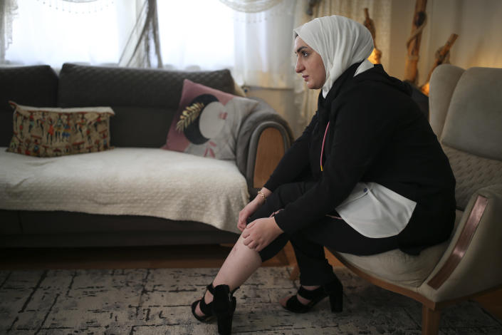 Fatima Alzahra Shon, 32, a Syrian refugee, shows the wound on her leg to The Associated Press during an interview in Istanbul, Friday, Sept. 17, 2021. (AP Photo/Emrah Gurel)