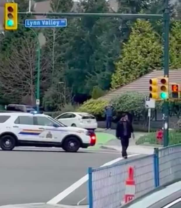 A screen grab from a video posted on social media shows the suspect police arrested after multiple people were stabbed in North Vancouver on Saturday. (Agnieszka Wyka/Twitter - image credit)
