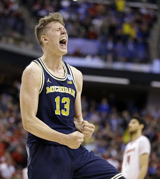 Michigan forward Moritz Wagner (13) celebrates a 73-69 win over Louisville in a second-round game in the men's NCAA college basketball tournament in Indianapolis, Sunday, March 19, 2017. (AP Photo/Michael Conroy)