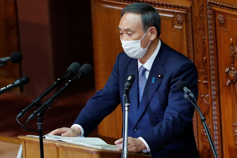 Japanese Prime Minister Yoshihide Suga gives his first policy speech in parliament in Tokyo