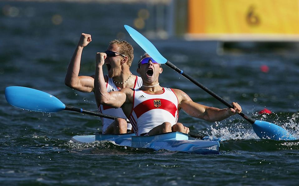 ATHENS - AUGUST 28: Ronald Rauhe and Tim Wieskoetter of Germany celebrate their victory in the men's K-2 class 500 metre final on August 28, 2004 during the Athens 2004 Summer Olympic Games at the Schinias Olympic Rowing and Canoeing Centre in Athens, Greece. (Photo by Jonathan Ferrey/Getty Images)