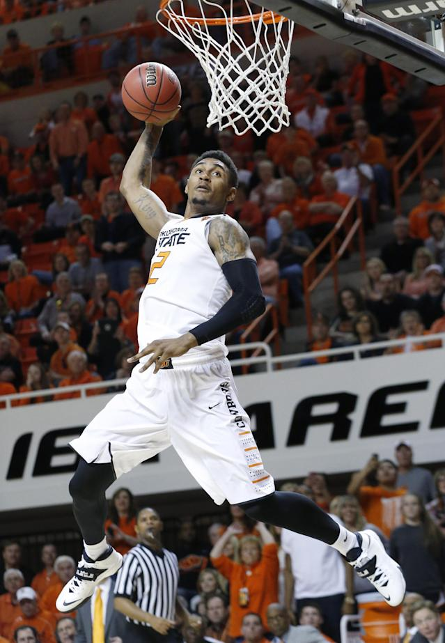 Oklahoma State wing Le'Bryan Nash (2) goes up for a dunk in the second half of an NCAA college basketball game against Texas Tech in Stillwater, Okla., Saturday, Feb. 22, 2014. Oklahoma State won 84-62. (AP Photo/Sue Ogrocki)