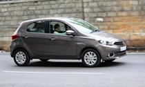 <p>Tata Tiago; Price Range: Rs 3.27 to 4.99 lakh; Mileage: 23-27 kmpl </p>