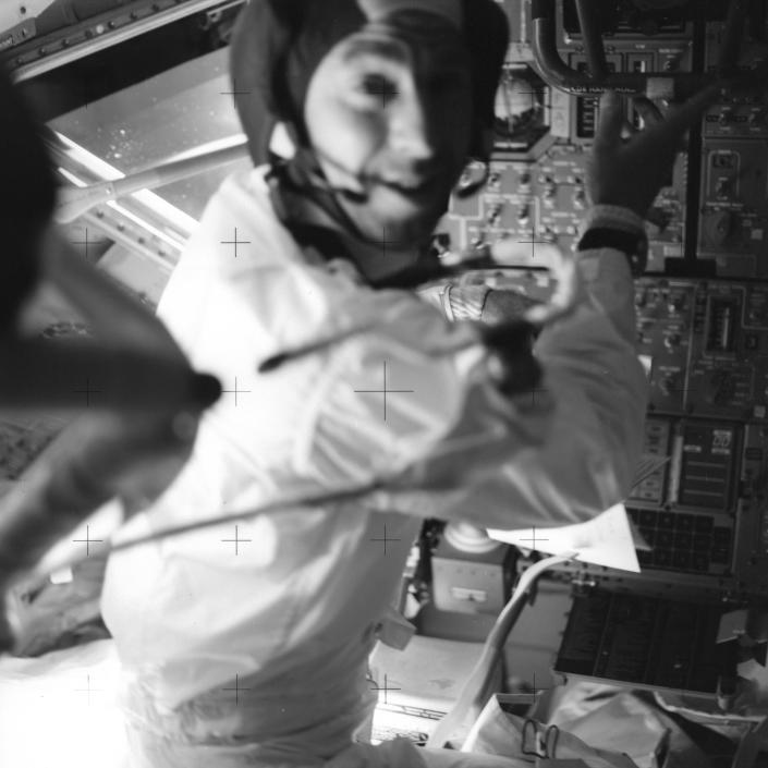 In this April 17, 1970 photo made available by NASA, astronaut Jim Lovell, inside the Apollo 13 lunar module, prepares it for jettison before returning to the command module for splashdown in the Pacific Ocean. (NASA via AP)