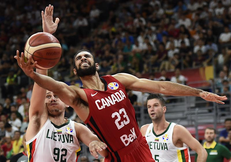Canada's Phil Scrubb (C) fights for the ball with Lithuania's Edgaras Ulanovas (L) during the Basketball World Cup Group H game between Lithuania and Canada in Dongguan on September 3, 2019. (Photo by Ye Aung Thu / AFP) (Photo credit should read YE AUNG THU/AFP/Getty Images)