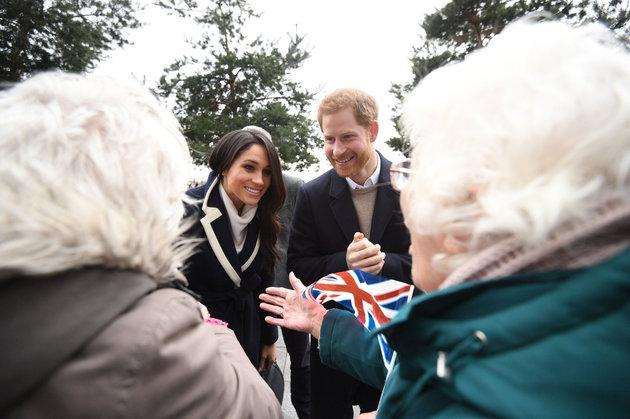 Prince Harry and Meghan Markle talk to sisters Jean Dickinson and Irene Gould while on a walkabout during a visit to Millennium Point in Birmingham
