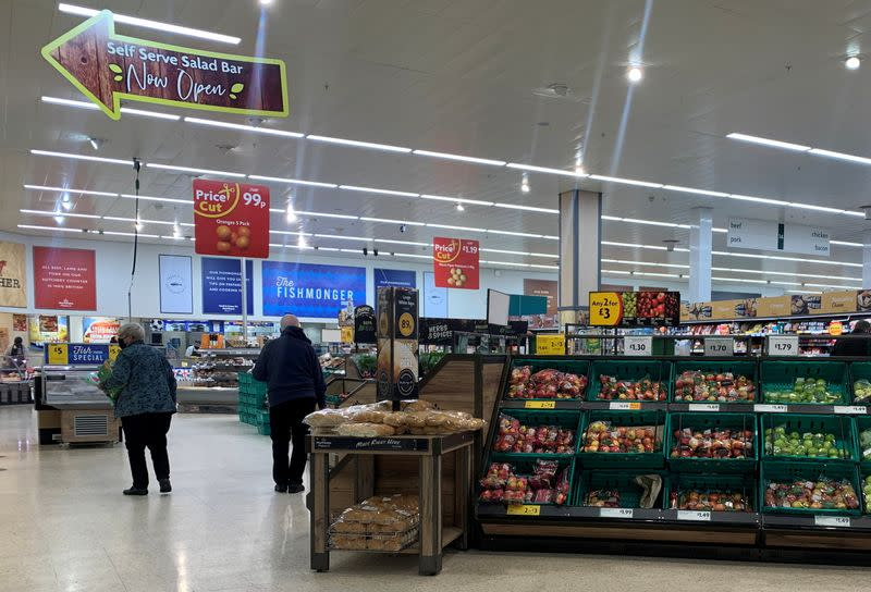 Customers wearing face masks are seen inside a Morrisons supermarket in New Brighton