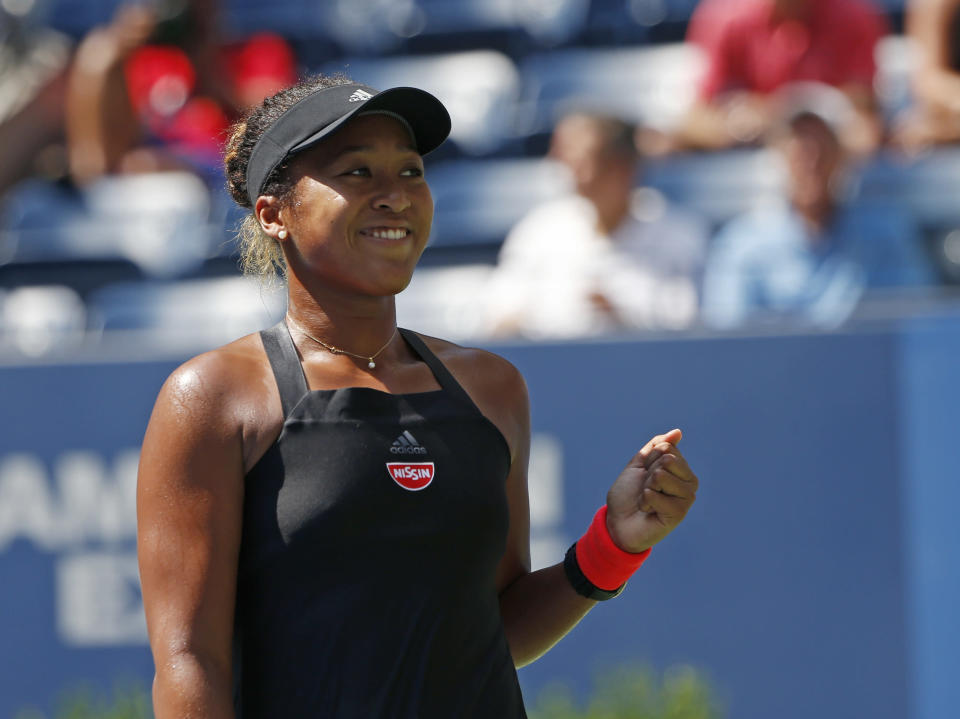 Naomi Osaka, of Japan, reacts after defeating Lesia Tsurenko, of Ukraine, during the quarterfinals of the U.S. Open tennis tournament, Wednesday, Sept. 5, 2018, in New York. (AP Photo/Jason DeCrow)