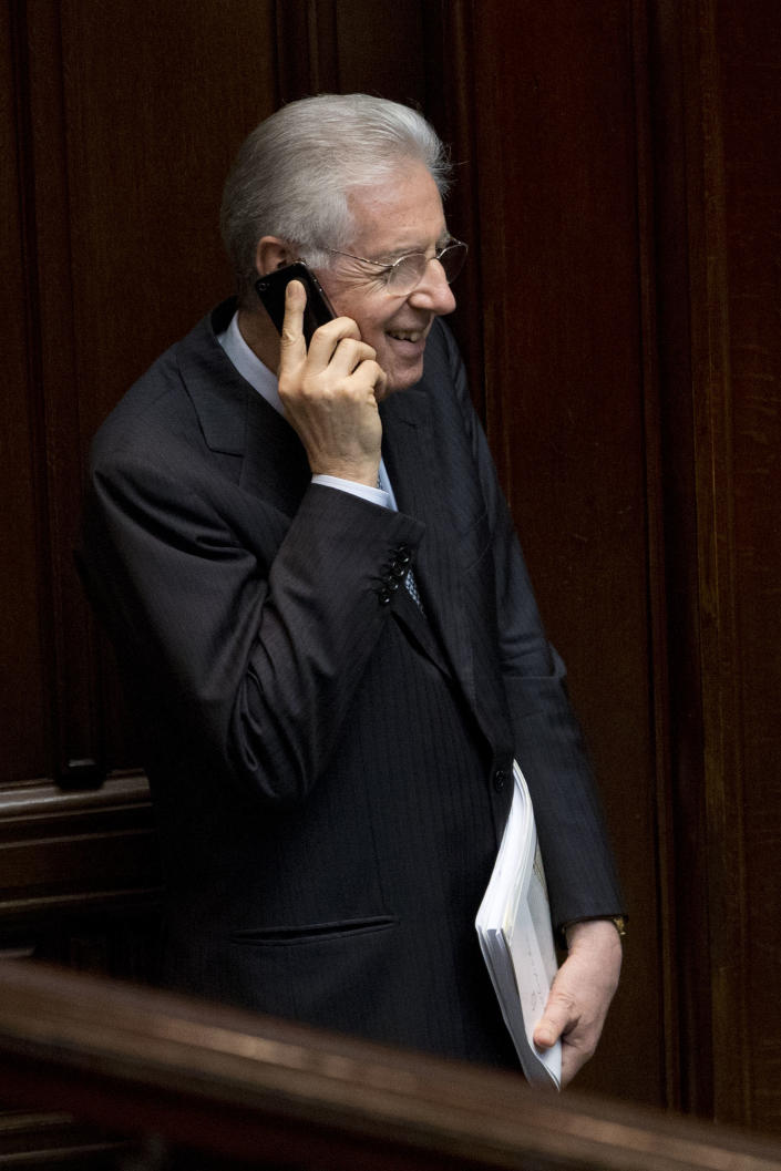 Italian Premier Mario Monti talks on the phone after voting on a new president whose first job will be to seek the formation of a new government after inconclusive elections, in Rome Friday, April 19, 2013 Italy's Parliament has opened a third round of voting for the nation's president after two inconclusive votes a day earlier. In a bid to change the dynamic during Friday's voting, the center-left leader proposed former Premier Romano Prodi for the post. However, Silvio Berlusconi's center-right has already signaled its opposition to the man who twice beat Berlusconi in national elections. (AP Photo/Andrew Medichini)