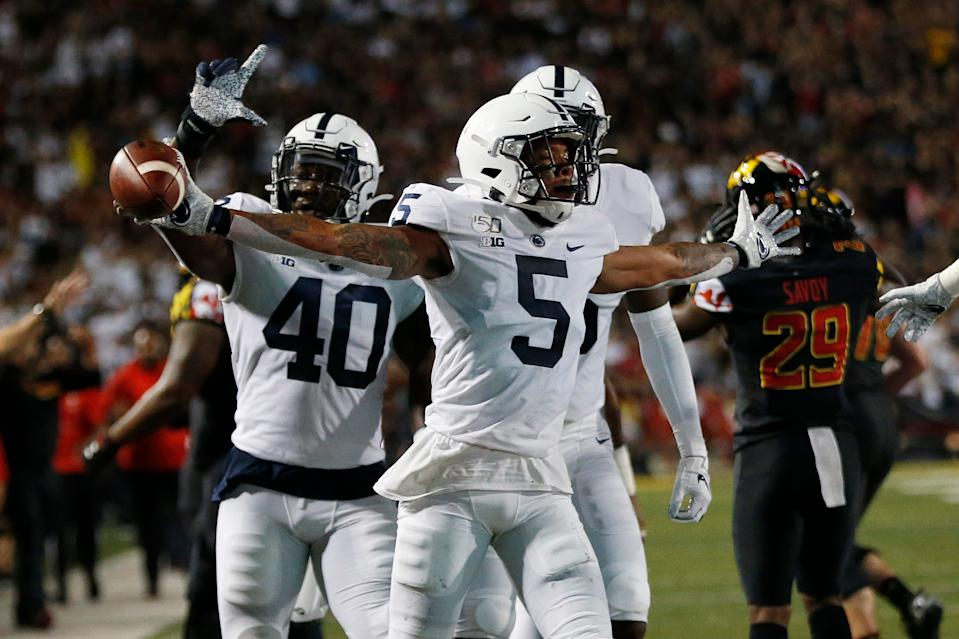 Penn State cornerback Tariq Castro-Fields (5) celebrates after intercepting a pass against Maryland in the first quarter at Capital One Field at Maryland Stadium.