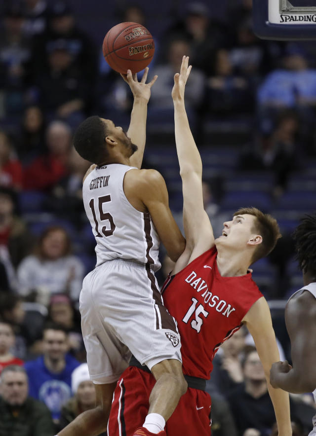St. Bonaventure forward LaDarien Griffin (15) shoots over Davidson forward Oskar Michelsen (15) during the first half of an NCAA college basketball game in the semifinals of the Atlantic 10 Conference tournament, Saturday, March 10, 2018, in Washington. (AP Photo/Alex Brandon)
