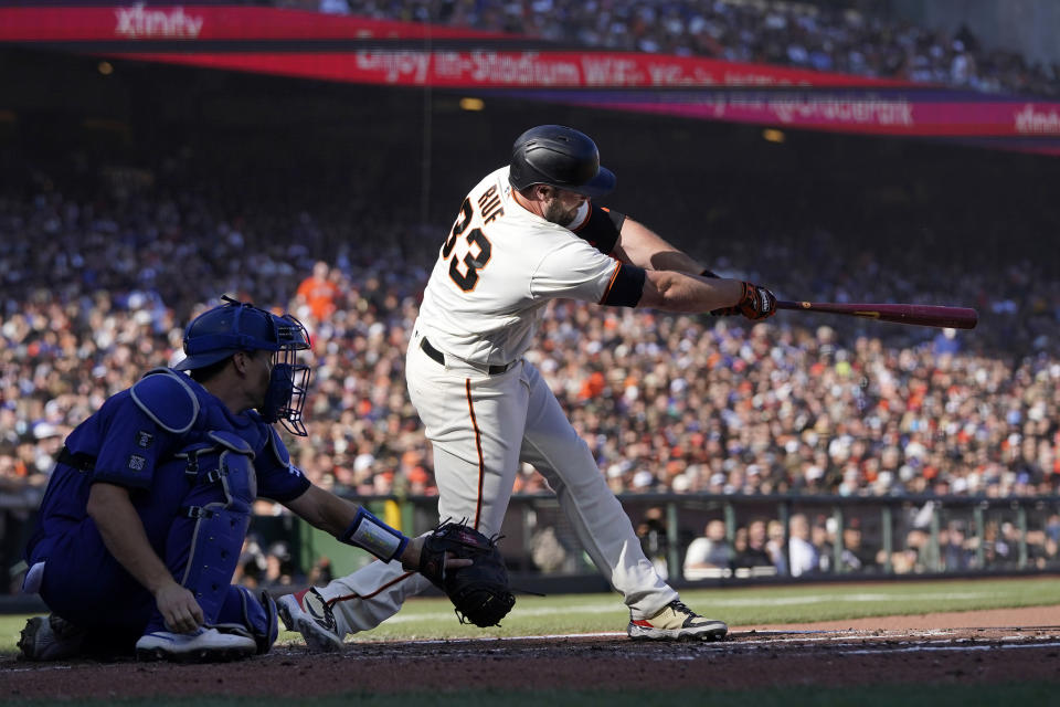 San Francisco Giants' Darin Ruf, right, hits an RBI-single in front of Los Angeles Dodgers catcher Will Smith during the second inning of a baseball game in San Francisco, Sunday, Sept. 5, 2021. (AP Photo/Jeff Chiu)